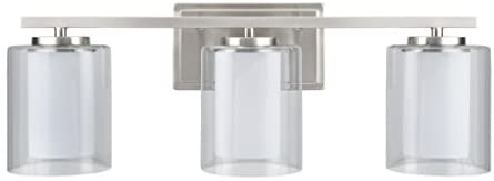 Aspen Creative 62103, Three-Light Metal Bathroom Vanity Wall Light Fixture, 23″ Wide, Transitional Design in Satin Nickel with Clear Glass Shade